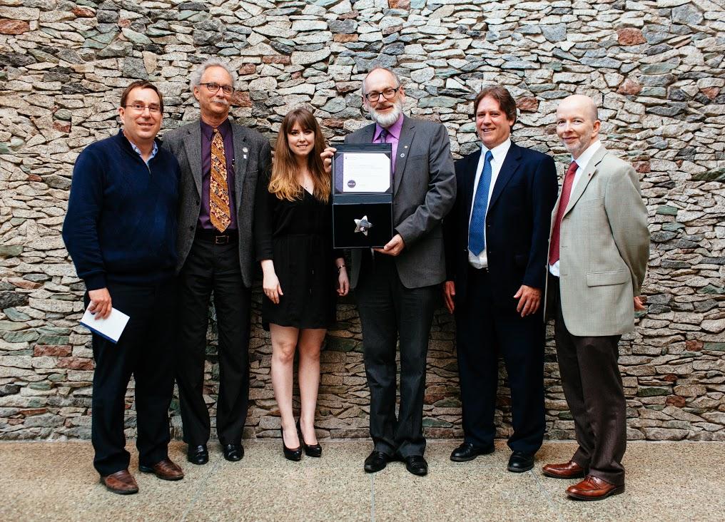 Warren Poole, Chris McKesson, Adrianna Eyking, Jon Mikkelsen, Dan McGreer, and Iain Braidwood with the Peter Larkin Award