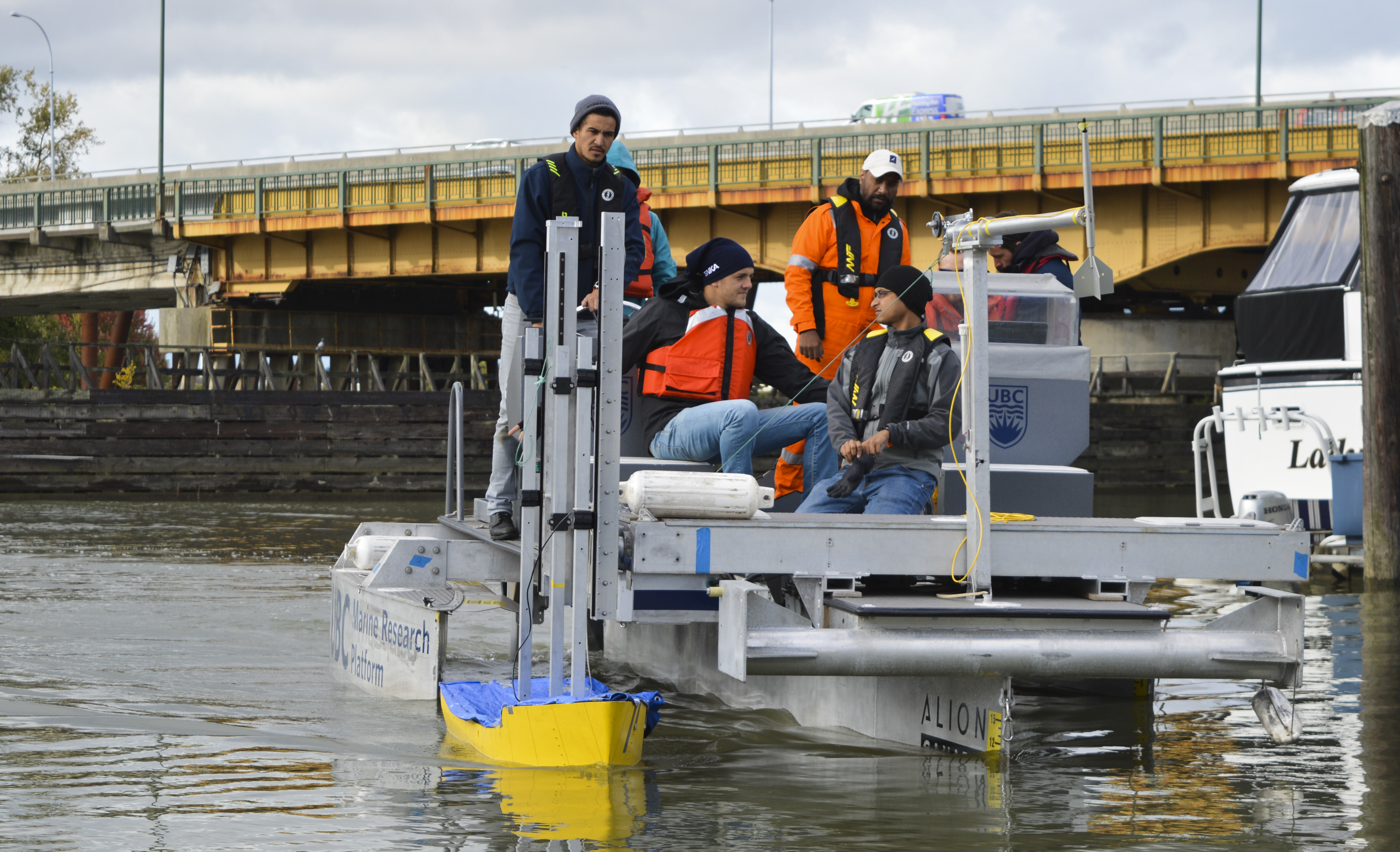 Students testing their model hull design aboard the new UBC Marine Research Platform.